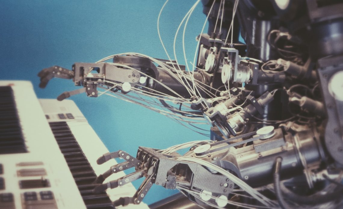 artistic creation robot playing piano